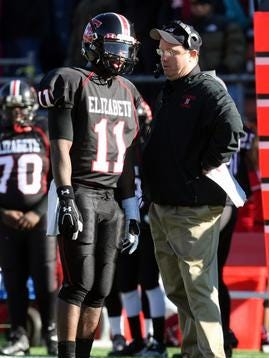 Elizabeth head football coach John Quinn (right) talks with Phillip Walker as Elizabeth takes on Piscataway during the North 2 Group IV championship in 2011.