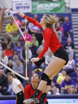 Laingsburg's Maya Ferland (right) is one of the Lansing area's top volleyball players in 2017. The senior was a Class C first team all-state selection last season.