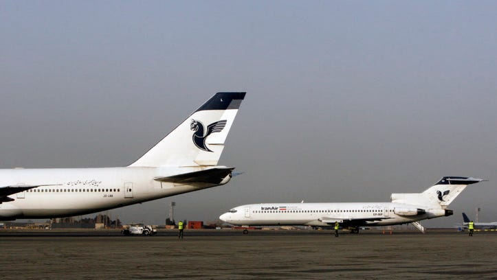 Two passenger planes of Iran's national air carrier, Iran Air, are parked March 2, 2008, at the Mehrabad Airport in Tehran.
