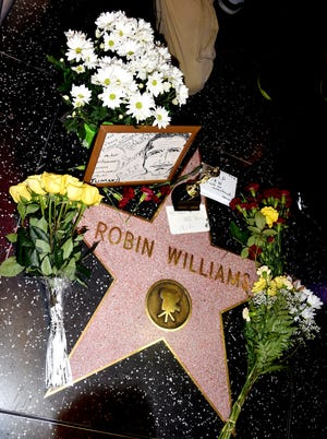 Fans pay tribute at Robin Williams' star on the Hollywood Walk of Fame on Aug.  11.