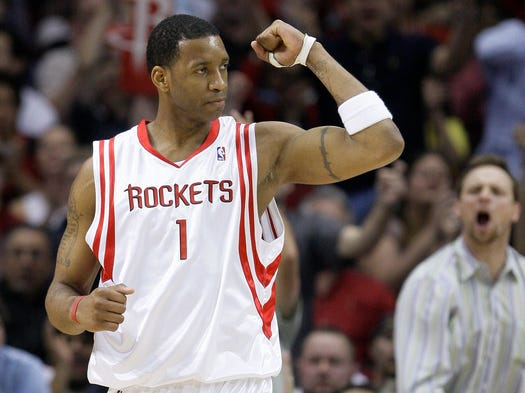 Tracy McGrady, seven-time NBA All-Star and two-time NBA scoring champion, retired Aug. 26 at age 34. Flip through this gallery for shots from his career.