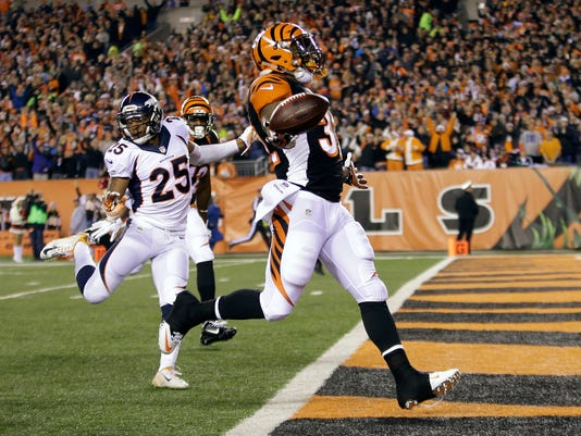 Cincinnati Bengals running back Jeremy Hill (32) celebrates after running 85 yards for a touchdown during the first half of an NFL football game against the Denver Broncos on Monday, Dec. 22, 2014, in Cincinnati. (AP Photo/AJ Mast)
