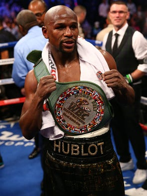 Aug. 26, 2017: Floyd Mayweather Jr. celebrates his