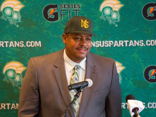 Latrell Scott speaks at a news conference in Norfolk, Va., after being introduced as the new head NCAA college football coach at Norfolk State University Tuesday morning, Dec, 16, 2014.  (AP Photo/The Virginian-Pilot, Bill Tiernan)  MAGS OUT