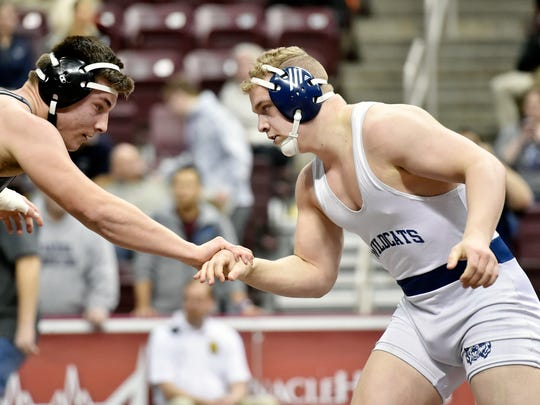 Dallastown's Bryce Shields, right, wrestles Pocono