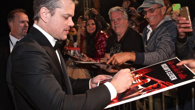 Actor Matt Damon signs autographs to fans during the 2016 Palm Springs International Film Festival on Saturday.