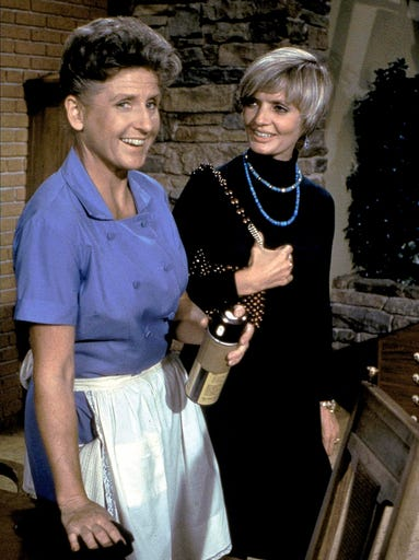 Ann B. Davis, wearing Alice's trademark blue dress, and Florence Henderson appear in an episode of 'The Brady Bunch.' Davis died Sunday after falling at her home in San Antonio.
