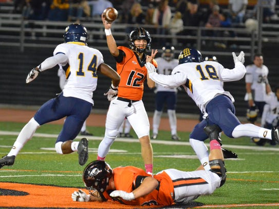 Quarterback Jake Constantine delivers a pass during