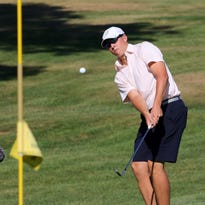 Josh Holling chips on to the 14th green at Soaring Eagles Golf Course during the final round of the Twin Tiers Championship on Sunday.