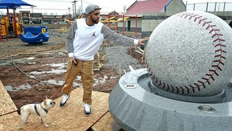 """During a symbolic ceremony, Cy Young Award-winning pitcher David Price, a Murfreesboro native, gives a push on the large baseball fountain to """"get the ball rolling"""" on Miracle Field, which is still under construction in Murfreesboro, on Monday, Jan. 23, 2017."""