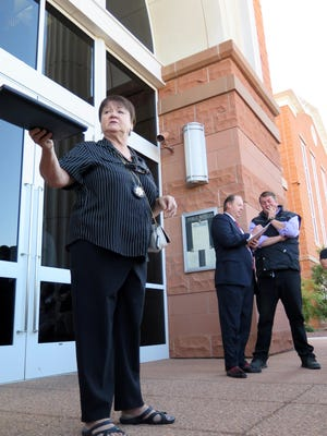 Washington County Constable Jean Dickson takes bids during an auction Monday at the 5th District Courthouse in St. George. Willie Jessop, right, a onetime bodyguard of imprisoned polygamous sect leader Warren Jeffs now estranged from his former employer's church, was the high bidder for the 2007 Cadillac Escalade that Jeffs was riding in when he was arrested in 2006. Jessop bid $30,000 for the vehicle and $50,000 for its contents, which at the time of the arrest included cash, gift cards, laptop computers and other personal items.