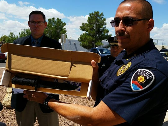 Las Cruces Police Chief Jaime Montoya holds a 14-inch-long