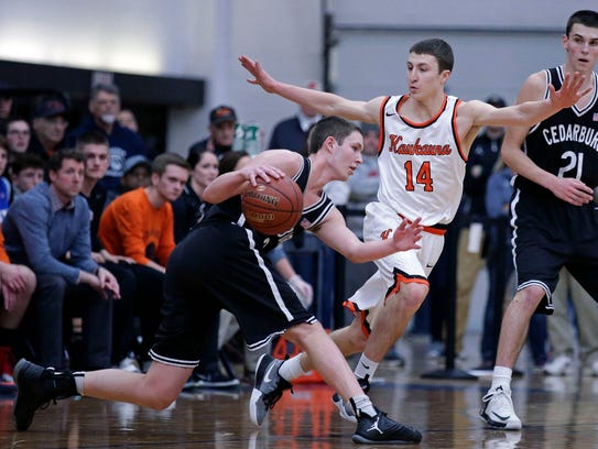 Brad Vosters of Kaukauna defends against a drive by John Diener of Cedarburg in a WIAA D2 sectional final in 2017 at Menasha High School.  Ron Page/USA TODAY NETWORK- Wisconsin