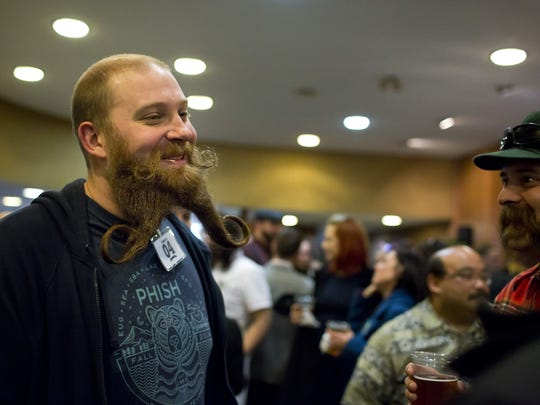 JEFFREY M. SMITH/TIMES HERALD Douglas Walsh of Port Huron laughs while talking with others in the lobby during the Blue Water Social Club 'Stache Bash Saturday at McMorran Theater. Douglas Walsh, of Port Huron, laughs while talking with others in the lobby during the Blue Water Social Club 'Stache Bash Saturday, March 28, 2015 at McMorran Theater.