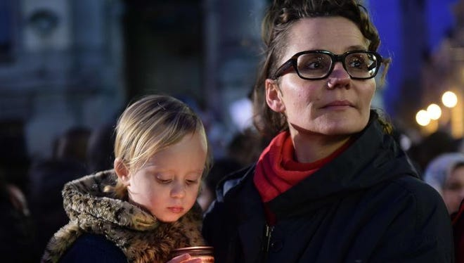 People attend a candlelight vigil for the victims of the Paris attacks in Brussels' Molenbeek district on Nov. 18, 2015. Molenbeek has come under growing scrutiny as a hotbed of Islamic radicalism in Europe, with several major attacks and plots linked to the down-at-heel district.