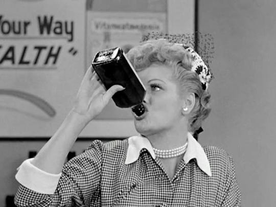 "Lucille Ball in the classic ""Vitameatavegamin"" episode of ""I Love Lucy."""