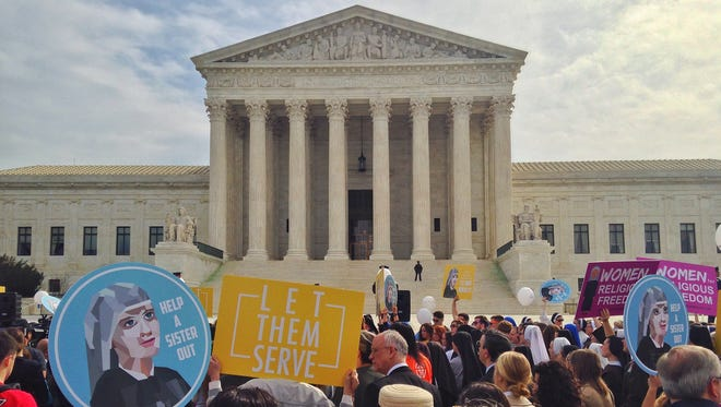 Supporters of religious organizations that want to ban contraceptives from their health insurance policies on religious grounds rally outside the Supreme Court on March 23, 2016.