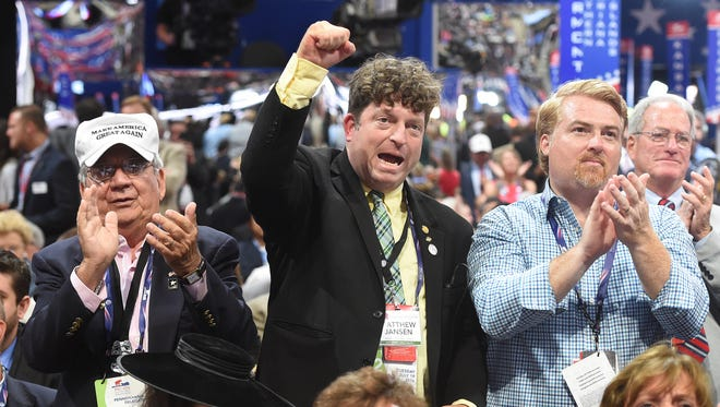 From left: Joe Sacco, Matthew Jansen and Marc Scaringi, Pennsylvania delegates representing the 4th Congressional District, celebrate when Alabama cast it votes for Donald Trump during the Republican National Convention held at the Quicken Loans Arena on Tuesday, July 19, 2016.