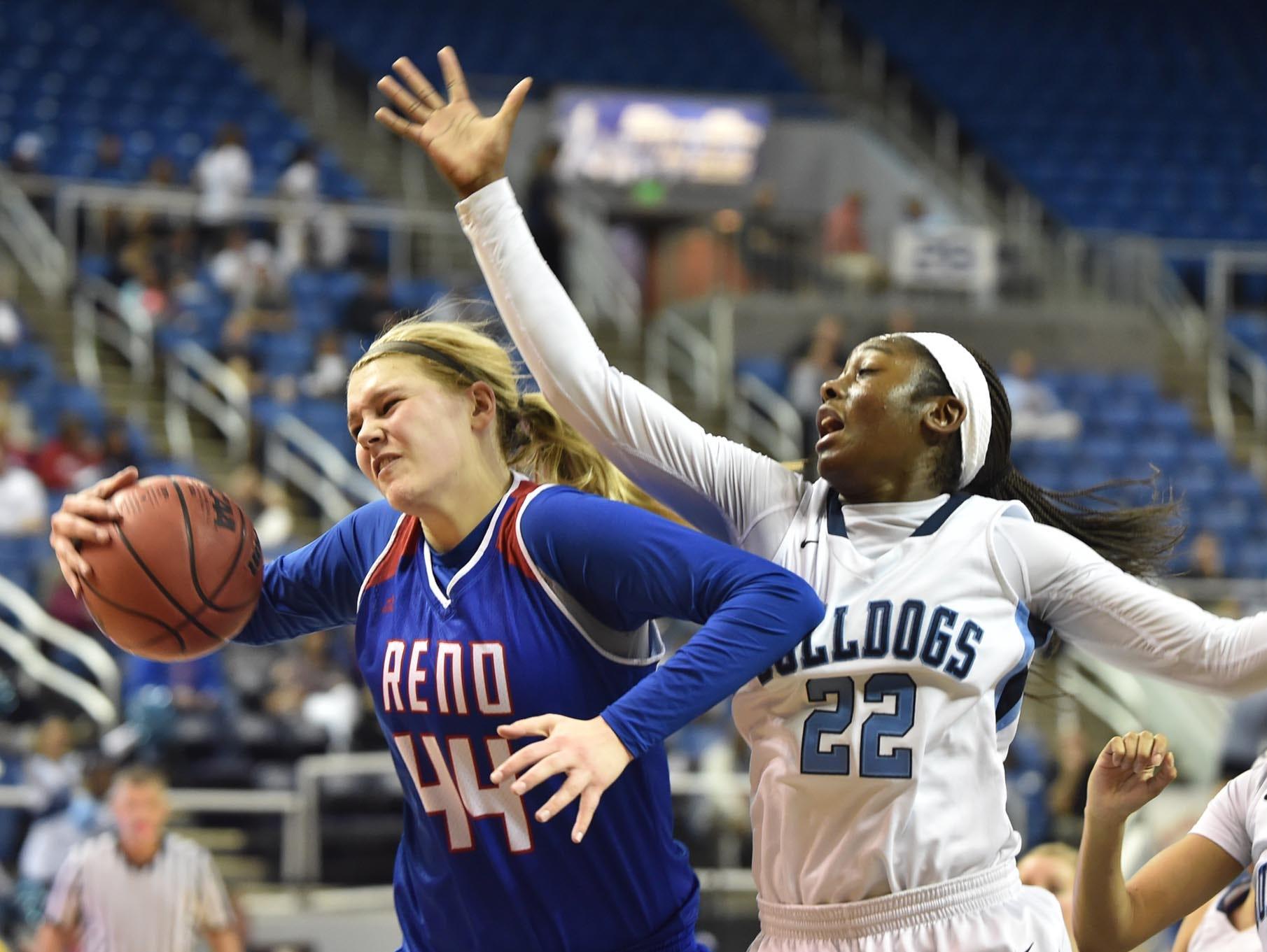 Reno senior Mallory McGwire grabs a rebound against Centennial's Eboni Walker on Friday.