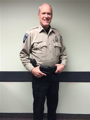 This photo provided by the Sublette County Sheriff's Office shows Undersheriff Mark Farrell wearing a new uniform at the Sheriff's Office on Monday, Feb. 2, 2015, in Pinedale, Wyo. The new sheriff of a Wyoming county has banned his deputies from wearing cowboy hats and cowboy boots, a change that led one longtime deputy to retire rather than give up his Western attire. Sublette County Sheriff Stephen Haskell imposed the new dress code in the western Wyoming county that includes Pinedale, which True West magazine recently named a true Western town. (AP Photo/Sublette County Sheriff's Office, Sgt. Katherine A. Peterson)