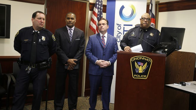 Mayor John Cranley and Police Chief Eliot Isaac (right) answer questions during a press conference on March 26, 2017, about the shooting at the Cameo nightclub. Dave Bailey, assistant police chief Cincinnati Police Department (left), and  Roy Winston, assistant chief, Cincinnati Fire Department, join Cranley and Isaac.