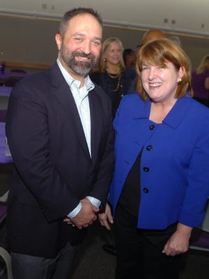 Karen Bolsen and George Gurrola pose for a photo together at their farewell reception.