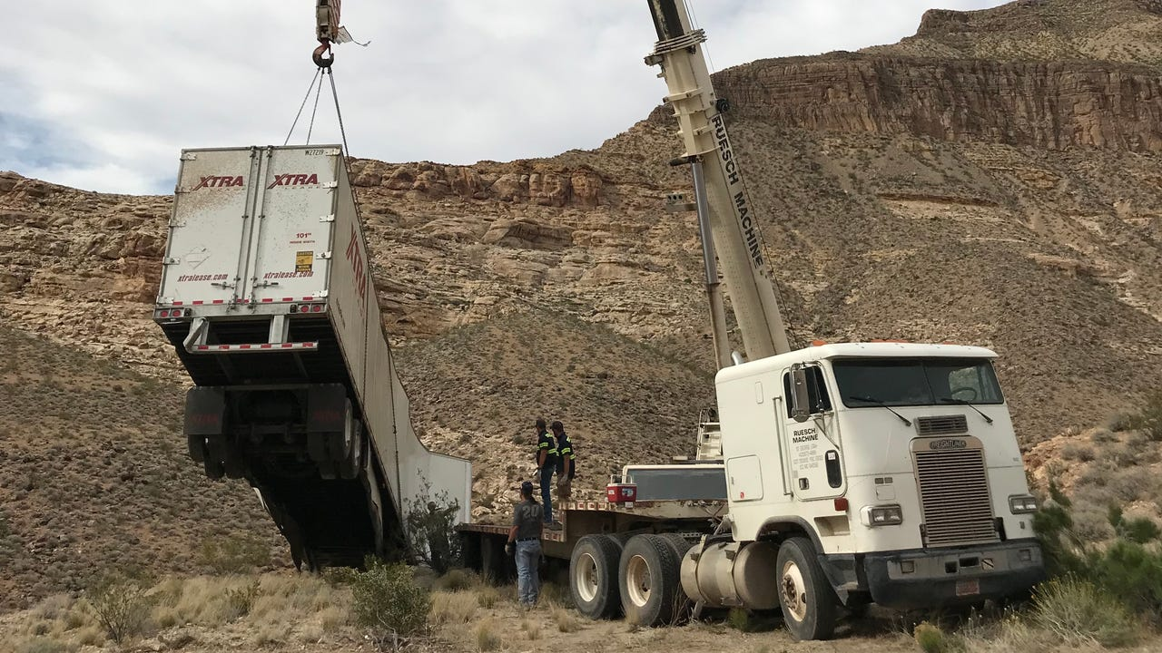 Crews use a crane to pull the trailer out of the Virgin River Gorge in the Arizona Strip on May 9, 2018. The truck veered off an embankment May 8. The driver, Liviu Stefen of Las Vegas, died. Melissa Galbraith/The Spectrum & Daily News