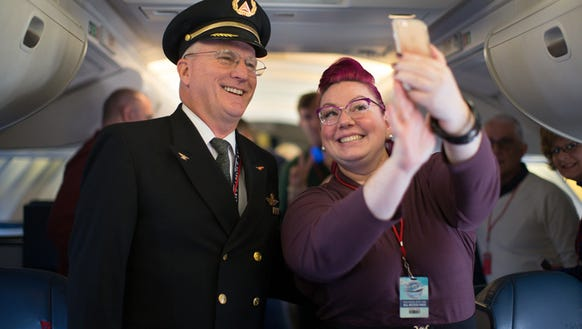 Delta Air Lines Capt. Paul Gallaher and Delta employee