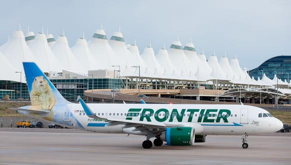 A Frontier Airlines Airbus A320neo taxies out from