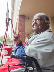 Salvation Army volunteer Alma Crumpton rings her bell Friday, Dec. 22, 2017, while collecting donations outside of Publix on Cervantes Street in Pensacola.