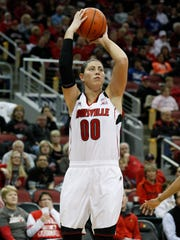 U of L's Sara Hammond, #00, shoots against Syracuse during their game at the KFC Yum! Center. Jan. 29, 2014