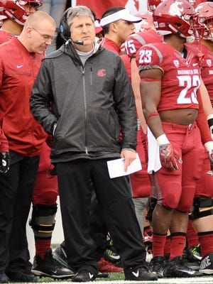 Washington State coach Mike Leach watches his team from the sideline.