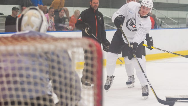 Left wing Isaac Ratcliffe (76) shoots during drills at Flyers development camp on Thursday, June 28.