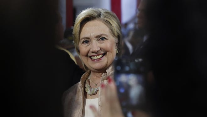 Democratic presidential candidate Hillary Clinton poses for a cell phone photo with audience members after speaking at campaign event at John Marshall High School in Cleveland on Aug. 17.