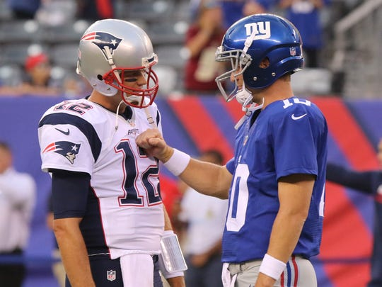 New England quarterback Tom Brady and New York Giants quarterback Eli Manning greet each other during warm ups.