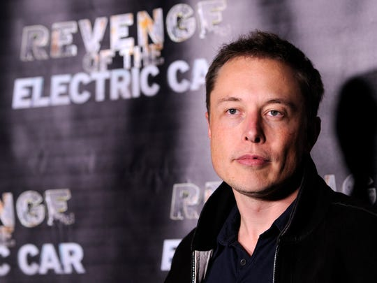 """Elon Musk, co-founder, chief executive and product architect of Tesla Motors, poses at the premiere of the documentary film """"Revenge of the Electric Car,"""" Friday, Oct. 21, 2011, at Tesla Motors in Los Angeles. The film is director Chris Paine's follow-up to his 2006 documentary, """"Who Killed the Electric Car?"""" (AP Photo/Chris Pizzello)"""
