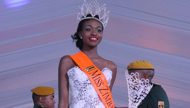 Miss Zimbabwe, Emily Kachote, walks on stage after being crowned on April 26, 2015. Organizers of the  Miss Zimbabwe pageant say they are investigating Kachote two weeks into her reign after photos allegedly showing her nude appeared on the Internet.