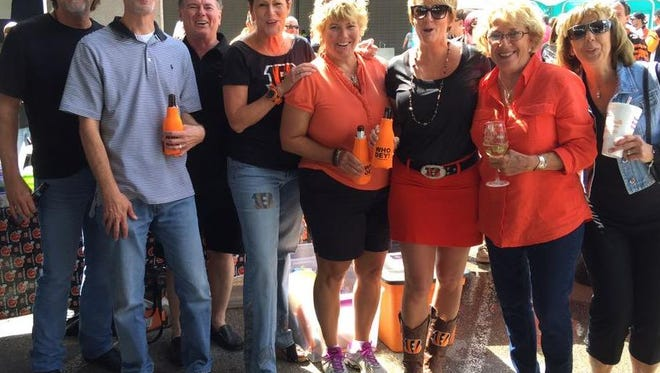 Katie Youngblood (3rd from right), poses for a photograph with some of the organizers of a tailgate under the Elm Street overpass at the foot of Paul Brown Stadium prior to the Sept. 20, 2015, game against the San Diego Chargers.