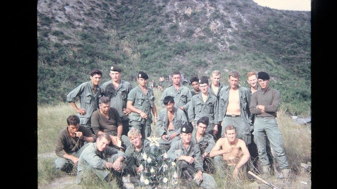 Members of the 4th platoon, CO. A., 1s Battalion, 7th Cavalry, 1st Calvary Division, in Vietnam in 1967-68 wrote to students at Yorkship School in Camden. Lt. Eugene Moppert of New Orleans, platoon leader ( far right with cap), was killed in February 1968.