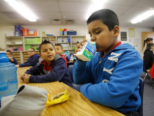 McCormick Elementary School second-grade student Noe Acosta drinks milk Friday at McCormick Elementary School in Farmington as part of the Breakfast After the Bell program.