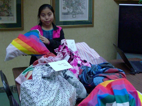 Alliah Immerfall, 8, with Sweet Dreams donations her friends gave her for her birthday in March.