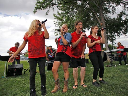Junior Jackson, left, Rachel Idzerda, Greg Harris and Sarah Marquez perform with fellow members of San Juan College's The Company June 6, 2015, during Fiesta Days at Minium Park in Aztec
