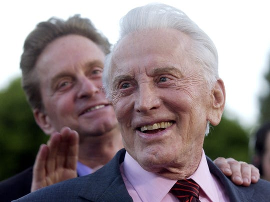 """Kirk Douglas, front, and his son, Michael, stars of the new film """"It Runs in the Family,"""" arrive at a special screening of the film in the Westwood section of Los Angeles, Monday, April 7, 2003. (AP Photo/Chris Pizzello) ORG XMIT: CACP102"""