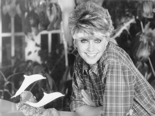Olivia Newton-John in the '80s: How many girls wanted the hairdo and the headband?