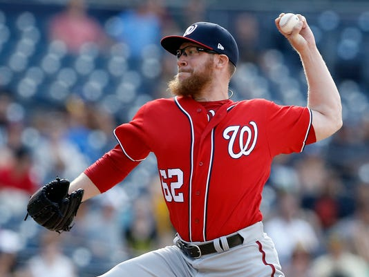 Washington Nationals closing pitcher Sean Doolittle throws to the plate against the San Diego Padres during the ninth inning of a baseball game in San Diego, Sunday, Aug. 20, 2017. The Nationals won 4-1. (AP Photo/Alex Gallardo)