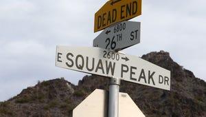 Squaw Peak Drive sign with Piestewa Peak (in the background) on Jan. 3, 2017 in Phoenix, Arizona.