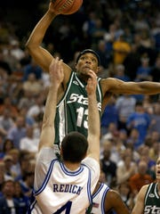 Maurice Ager goes in for a dunk over Duke's J.J.Redick.