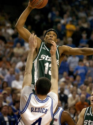 Maurice Ager dunks over Duke's J.J. Redick during the Spartans' 2005 Sweet 16 win.