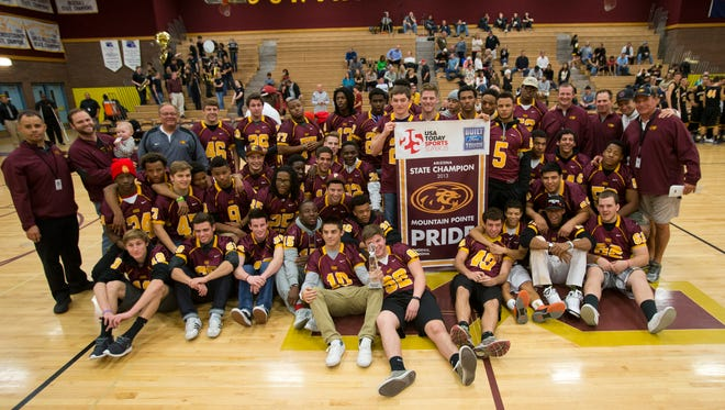 Mountain Pointe High School football team pose for a picture after receiving the USA TODAY Super 25 Trophy on Feb.  5, 2014.