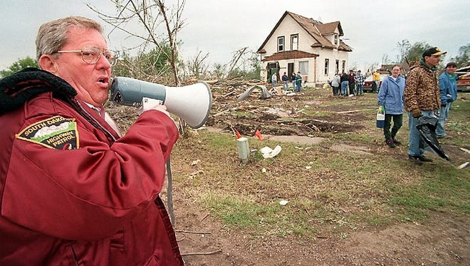In the aftermath of the tornado that devastated Spencer and killed six in 1998, Gov. Bill Janklow  directed efforts to clean up.   -Gov. Bill Janklow uses a bullhorn to direct cleanup activities this week in Spencer. The governor, one of the first to arrive at the scene of the tragedy, is camping in a motor home in town and leading relief efforts.
